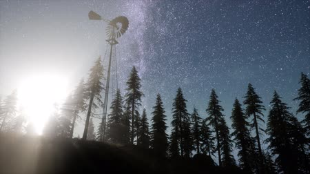 préri : retro windmill in mountain forest with stars. hyperlapse