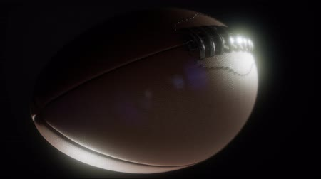 playoff : 4K Super slow motion flying football on black background