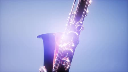 mouthpiece : Golden Tenor Saxophone on blue background with light Stock Footage