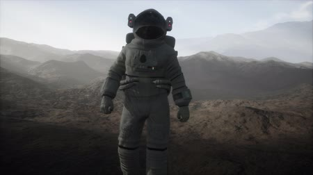 futurismo : astronaut on another planet with dust and fog