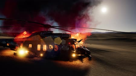 afghan : burned military helicopter in the desert at sunset