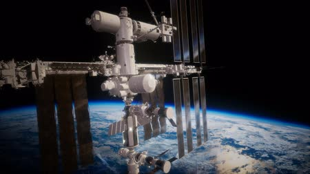 астрология : International Space Station in outer space over the planet Earth Стоковые видеозаписи