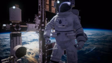 astronauta : International Space Station and astronaut in outer space over the planet Earth