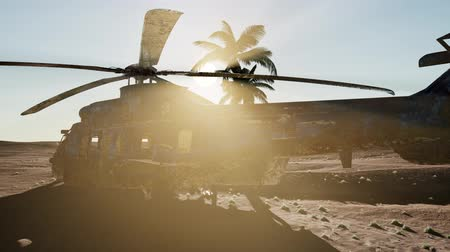 afghan : old rusted military helicopter in the desert at sunset