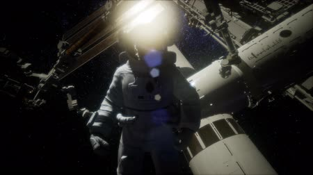 orbital : Astronaut outside the International Space Station on a spacewalk