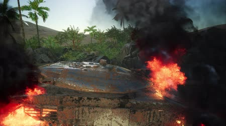 blindado : burned tank in the desert at sunset