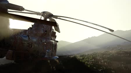 tropas : old rusted military helicopter in the desert at sunset