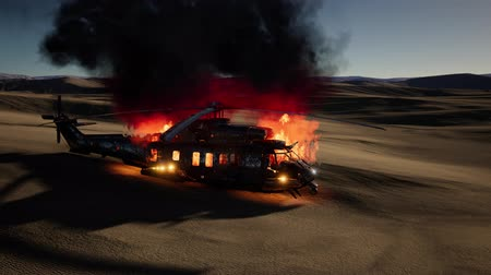 tropas : burned military helicopter in the desert at sunset