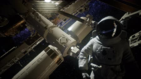 challenger : Astronaut outside the International Space Station on a spacewalk