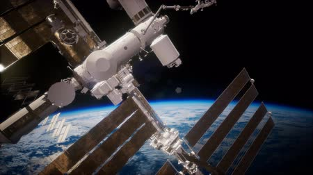 modul : International Space Station in outer space over the planet Earth Stock mozgókép