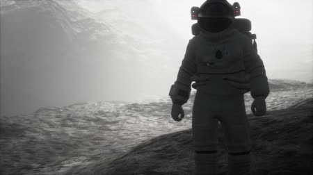 pionnier : astronaut on another planet with dust and fog