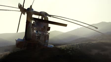 akt : old rusted military helicopter in the desert at sunset