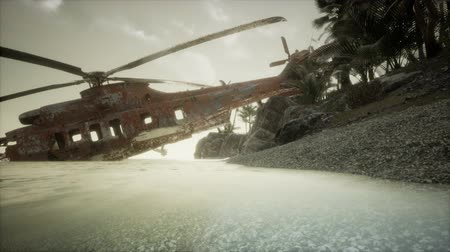 demolition : old rusted military helicopter near the island Stock Footage