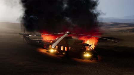 infantry : burned military helicopter in the desert at sunset