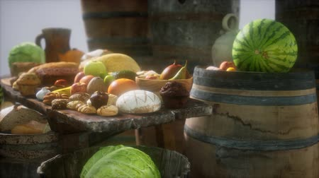 pince : food table with wine barrels and some fruits, vegetables and bread