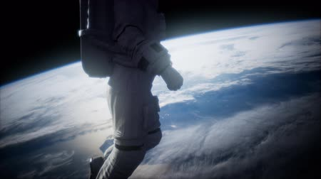 hvězdný : Astronaut in outer space against the backdrop of the planet earth Dostupné videozáznamy