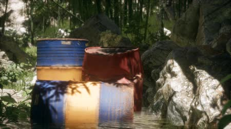 waste water : Rusty barrels in green forest Stock Footage
