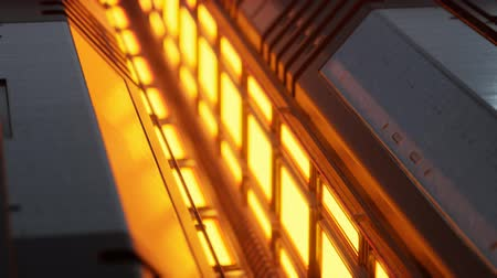 csillár : yellow lights and metal pannels in futuristic interior Stock mozgókép
