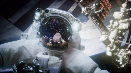 távcső : Astronaut at spacewalk. Stock mozgókép