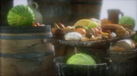 karczma : food table with wine barrels and some fruits, vegetables and bread