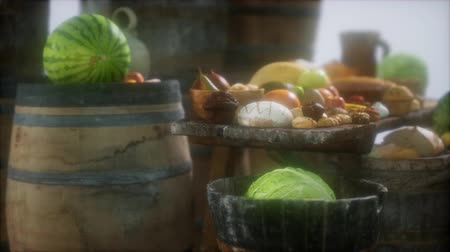 kelder : food table with wine barrels and some fruits, vegetables and bread