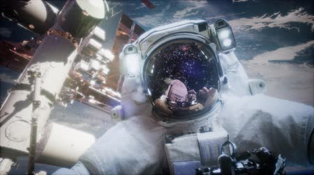 távcső : Astronaut at spacewalk. Elements of this image furnished