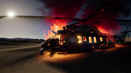 infantaria : burned military helicopter in the desert at sunset