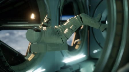 orbital : astronaut inside the orbital space station Stock Footage