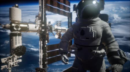 kosmická loď : International Space Station and astronaut in outer space over the planet Earth