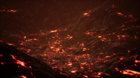 craters : Red Orange vibrant Molten Lava flowing onto grey lavafield and glossy rocky land Stock Footage