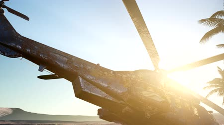 destruído : old rusted military helicopter in the desert at sunset