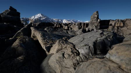 snow on grass : rock and stones in Alps mountains