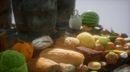 beczka : food table with wine barrels and some fruits, vegetables and bread