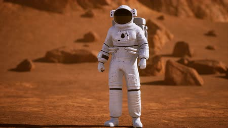 sefer : Astronaut on Mars Surface. Red Planet Covered in Gas and rock