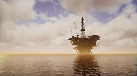 Offshore Jack Up Rig in The Middle of The Sea at Sunset Time Стоковые видеозаписи
