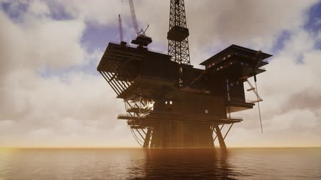 petróleo : Offshore Jack Up Rig in The Middle of The Sea at Sunset Time Vídeos