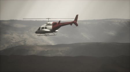 ローター : extreme slow motion flying helicopter near mountains with fog