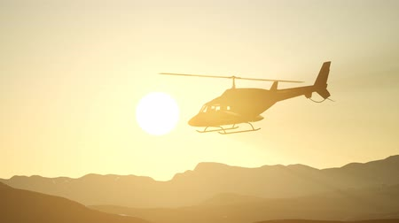 tomar : extreme slow motion flying helicopter and sunset sky