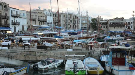 ciprus : KYRENIA, NORTHEN CYPRUS - OCTOBER, 10, 2015: yachts and motorboats stay at Harbour of Kyrenia, tourist place located on the northern coast of Cyprus