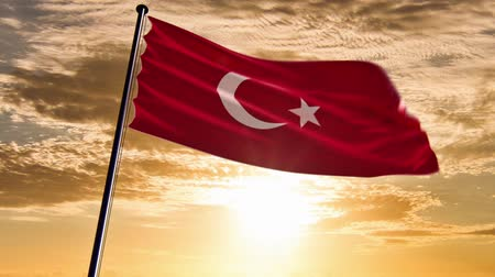 Turkey Flag, HQ animated on an epic sunset backgroundready to use animation of the turkish flag animated on an epic background with fast moving clouds. Stock mozgókép