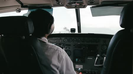 piloto : 1080p, Pilot Handles Instruments In Airplane