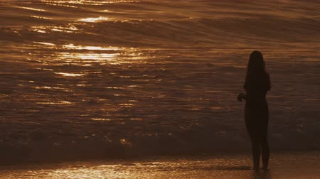 idil : Young, Beautiful Woman Taking Photos Of The Ocean At Golden Sunset, Graded Version, Slow Motion