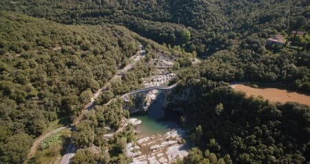 pont : Aerial, Pont Medieval De Lllierca, Pyrenees, Spain - graded Version Stock Footage
