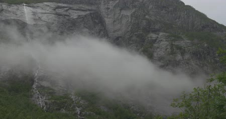 stony : Norwegian Waterfall Covered By Clouds