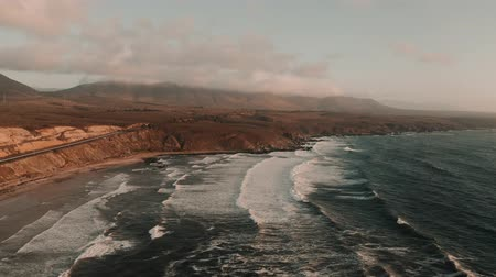 チリ : Aerial, Playa Chigualoco At Sunset, Chile - cine version 動画素材