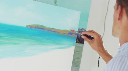 palette knife : artist draws palette knife on canvas, close-up Stock Footage