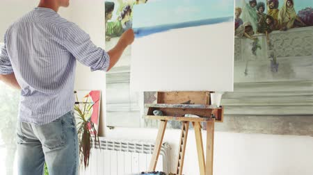 muse : male painter paints painting in his workshop