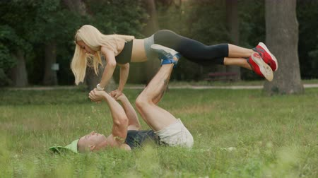 joints : marriades doing joint strength exercises in park on summer day