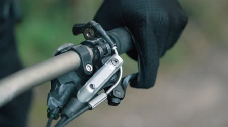 readiness : bikers hand holds steering wheel, super close-up Stock Footage
