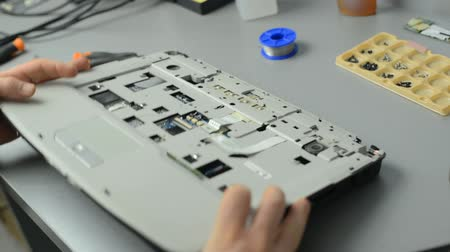 inventing : The engineer dismantles the laptop for repair